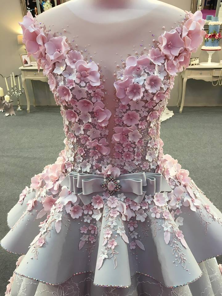 This wedding dress cake is insanely instricate and looks for Wedding dress travel case