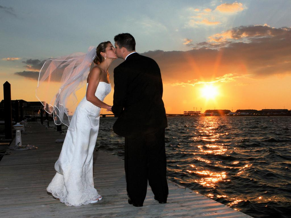 get married on the beach at sunset - Summer Wedding Ideas