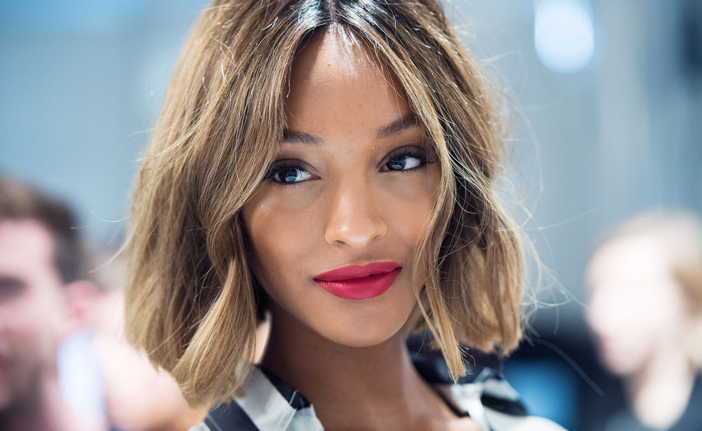 LONDON, ENGLAND - SEPTEMBER 15: Jourdan Dunn poses backstage at the Burberry Prorsum show during London Fashion Week Spring Summer 2015 at on September 15, 2014 in London, England. (Photo by Samir Hussein/WireImage)