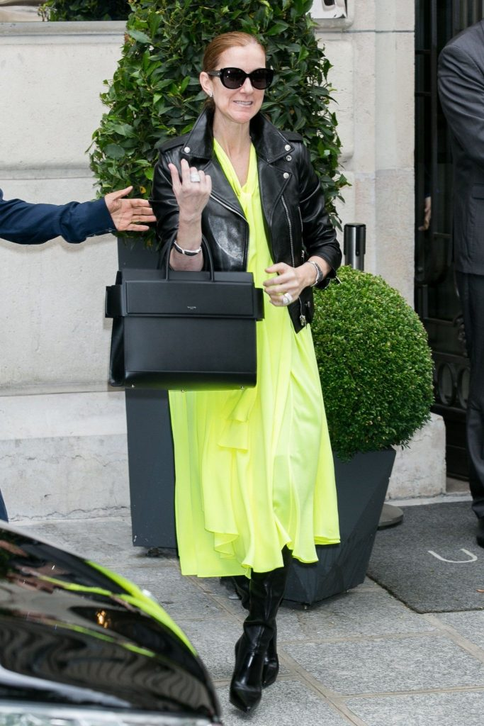 leather boots with a leather jacket and neon yellow tunic Celine Dion | 10 Reasons Why Celine Dion Is Our New Style Icon | Her Beauty
