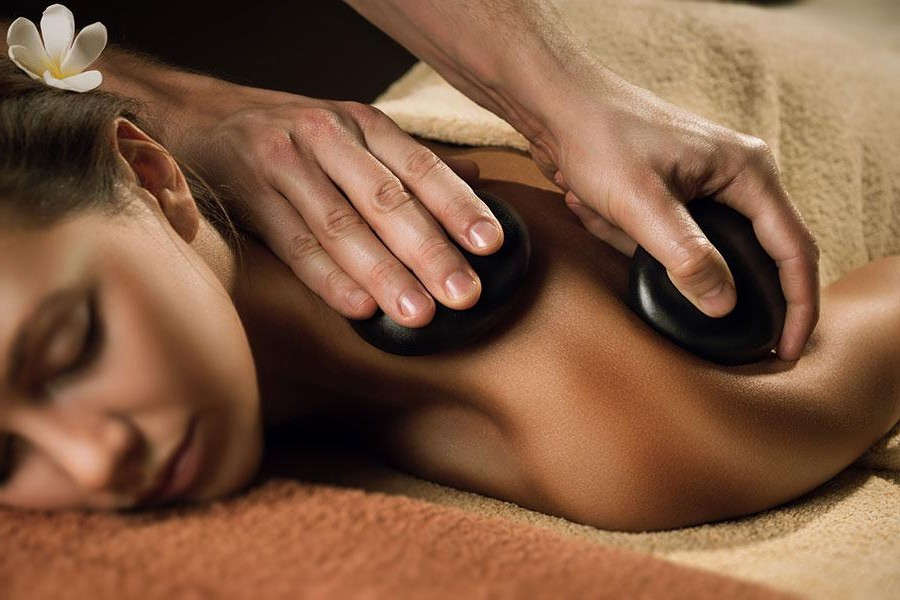 Hot Stone Massage | 9 Best Spa Treatments Every Women Should Try | Her Beauty