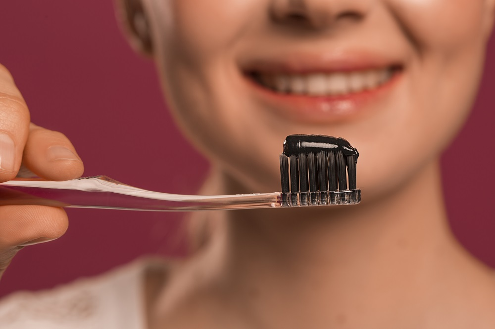 Everything You Need To Know AboutCharcoal Toothpaste | Her Beauty