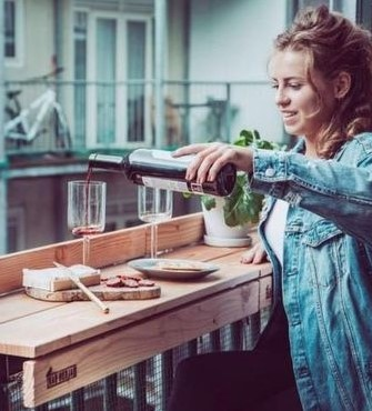 Elevated table Balcony   10 Cozy Balcony Ideas   Her Beauty