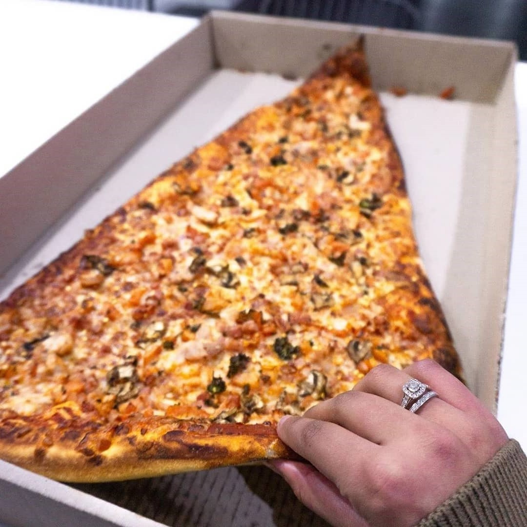 Slices cost over $20   New Foodie Trend Is A Giant Pizza Slice – The Biggest You've Seen   Her Beauty