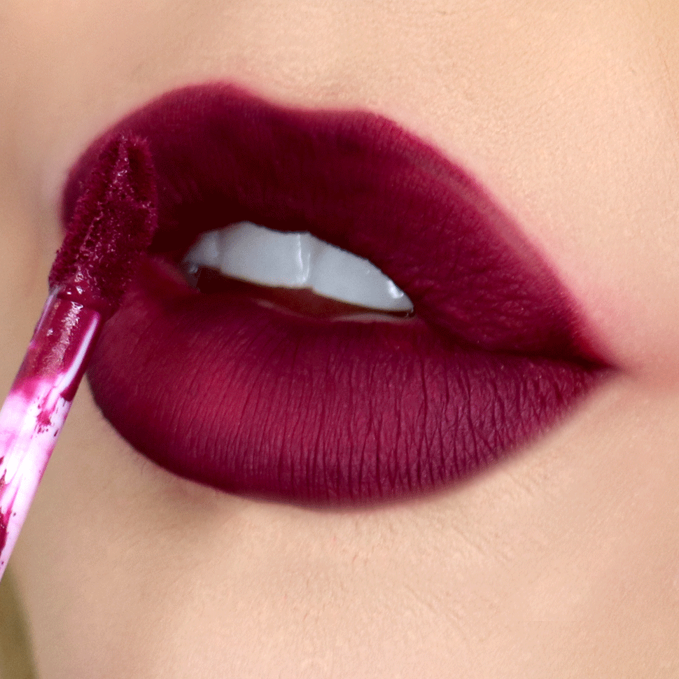 Deep purple lipstick | 10 Lipstick Tricks to Make Your Teeth Look Whiter | Her Beauty