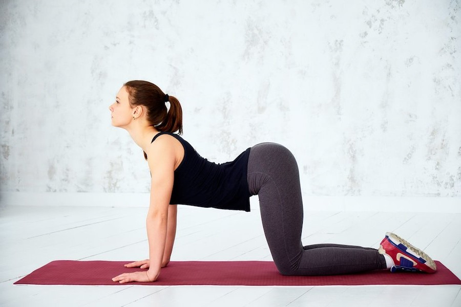 Cat/Cow | 9 Stretches To Ease Lower Back Pain | Her Beauty