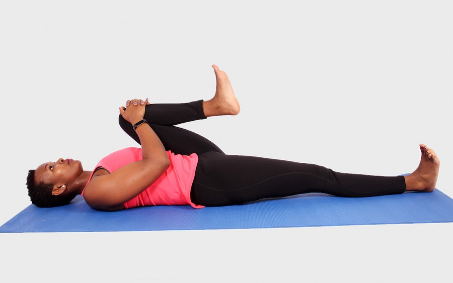 Knee To The Chest | 9 Stretches To Ease Lower Back Pain | Her Beauty