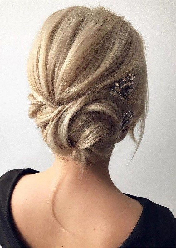 2. Side swept chignon | 10 Chignon Hairstyles You'll Freak Over | Her Beauty