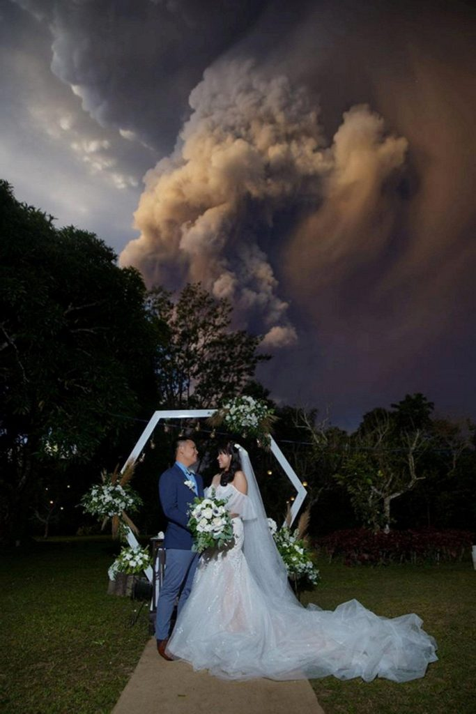 This image has an empty alt attribute; its file name is Wedding-Next-To-An-Erupting-Volcano2-683x1024.jpg