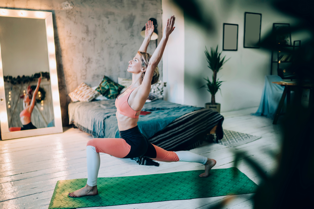Virabhadrasana (Warrior Pose) | 8 Yoga Poses to Boost Your Immunity, Flexibility, and Mood | Her Beauty